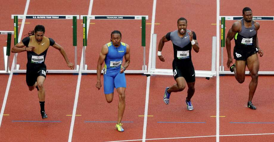 From left to right, Jason Richardson, Aries Merritt, Jeffrey Porter and David Oliver race for the finish in the men's 110 meter hurdles at the U.S. Olympic Track and Field Trials Saturday, June 30, 2012, in Eugene, Ore. Photo: Charlie Riedel, Associated Press / AP
