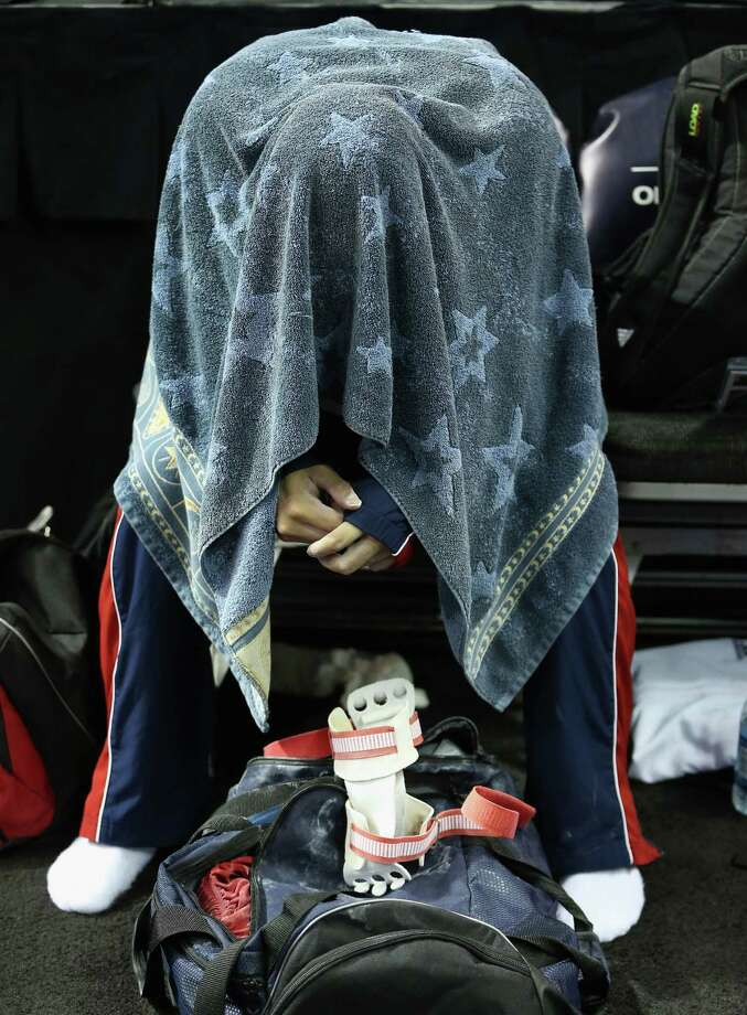 Danell Leyva covers himself with a towel before the start of competition on day 3 of the 2012 U.S. Olympic Gymnastics Team Trials at HP Pavilion on June 30, 2012 in San Jose, Calif. Photo: Ezra Shaw, Getty Images / 2012 Getty Images
