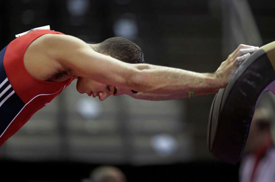 Danell Leyva stretches before competing in the final round of the men's Olympic gymnastics trials, S