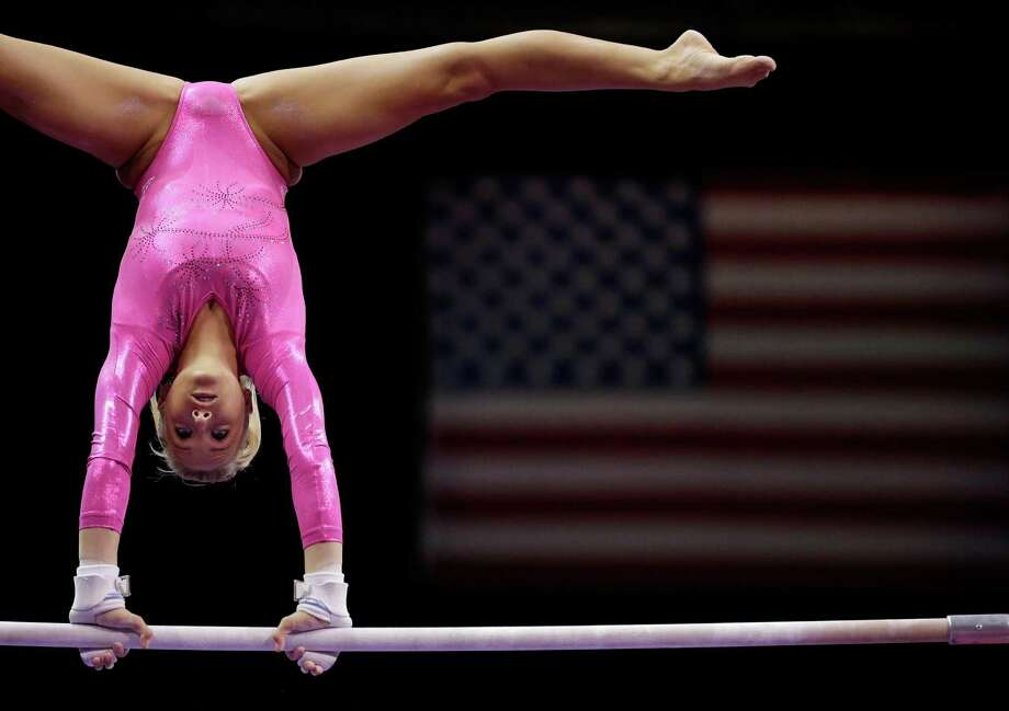 Nastia Liukin warms up for her routine on the uneven bars during the preliminary round of the women's Olympic gymnastics trials, Friday, June 29, 2012, in San Jose, Calif. Photo: Gregory Bull, Associated Press / AP