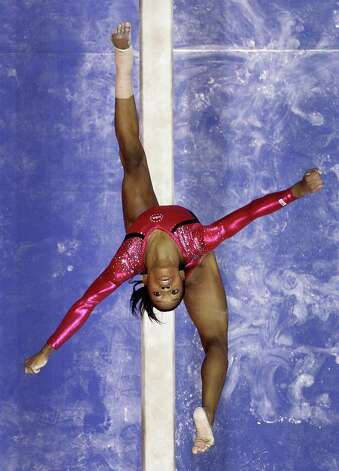 Gabby Douglas performs on the balance beam during the preliminary round of the women's Olympic gymnastics trials, Friday, June 29, 2012, in San Jose, Calif. Photo: Julie Jacobson, Associated Press / AP