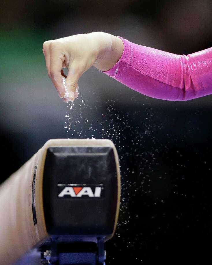 Nastia Liukin prepares for her routine on the balance beam during the preliminary round of the women's Olympic gymnastics trials, Friday, June 29, 2012, in San Jose, Calif. Photo: Gregory Bull, Associated Press / AP