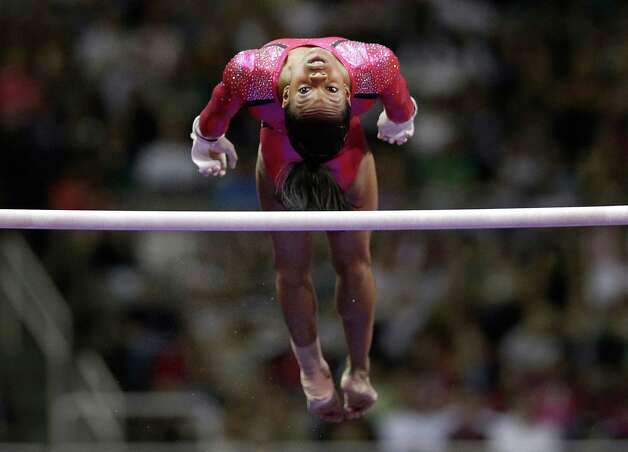 Gabby Douglas dismounts the uneven bars during the preliminary round of the women's Olympic gymnastics trials, Friday, June 29, 2012, in San Jose, Calif. Photo: Jae C. Hong, Associated Press / AP
