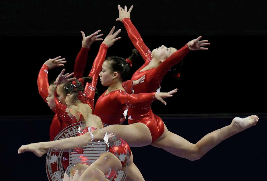 In this multiple exposure frame taken at one-fourth second intervals, Sarah Finnegan performs on the balance beam during the preliminary round of the women's Olympic gymnastics trials, Friday, June 29, 2012, in San Jose, Calif. Photo: Julie Jacobson, Associated Press / AP
