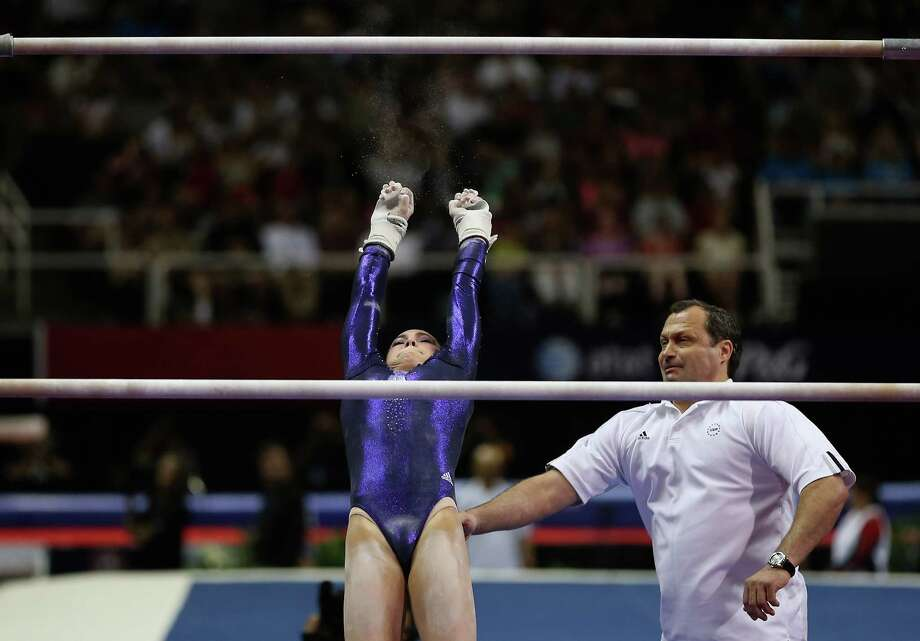 McKayla Maroney falls off the uneven bars as her coach Arthur Akopyian tries to spot her during day 2 of the 2012 U.S. Olympic Gymnastics Team Trials at HP Pavilion on June 29, 2012 in San Jose, Cali. Photo: Ezra Shaw, Getty Images / 2012 Getty Images