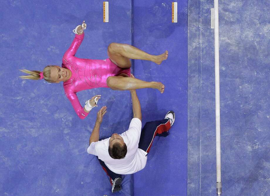 Nastia Liukin falls during her dismount off the uneven bars during the preliminary round of the women's Olympic gymnastics trials, Friday, June 29, 2012, in San Jose, Calif. Photo: Julie Jacobson, Associated Press / AP