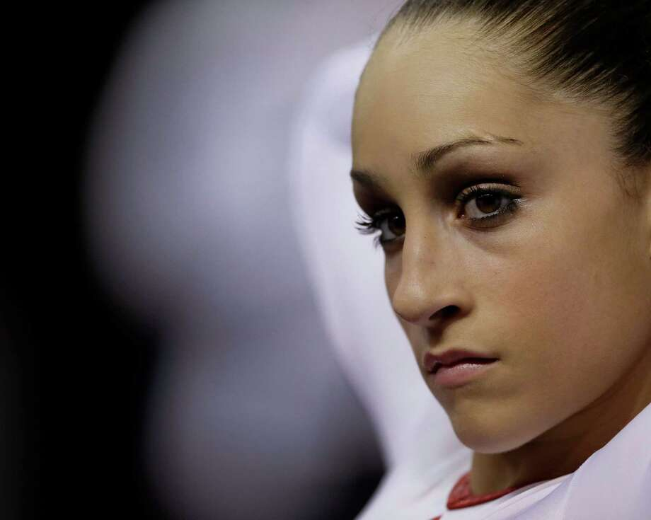 Jordyn Wieber waits her turn on the balance beam during the preliminary round of the women's Olympic gymnastics trials, Friday, June 29, 2012, in San Jose, Calif. Photo: Gregory Bull, Associated Press / AP