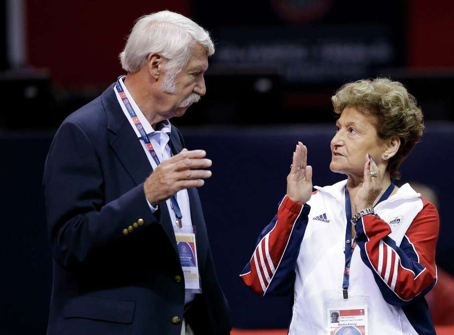 Bela Karolyi, left, and his wife Marta Karolyi talk on the arena floor before the start of the preliminary round of the women's Olympic gymnastics trials, Friday, June 29, 2012, in San Jose, Calif. Photo: Gregory Bull, Associated Press / AP