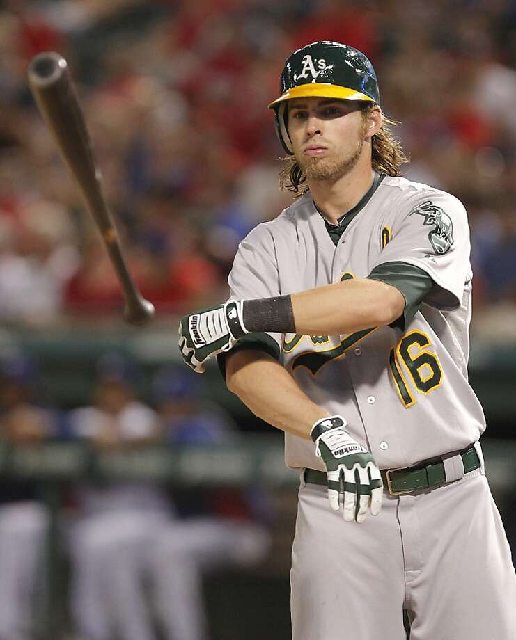 Oakland Athletics right fielder Josh Reddick tosses his bat in the eighth inning of a baseball game against the Texas Rangers Saturday, June 30, 2012, in Arlington, Texas.  The Rangers won the game 7-2.  (AP Photo/Tim Sharp) Photo: Tim Sharp, Associated Press