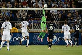 PALO ALTO, CA - JUNE 30:  Goal Keeper David Bingham #1 of the San Jose Earthquakes leaps to make a save in the second half against the Los Angeles Galaxy at Stanford Stadium on June 30, 2012 in Palo Alto, California. The Earthquakes won the game 4-3. (Photo by Thearon W. Henderson/Getty Images)