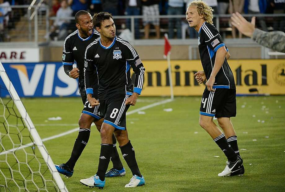 PALO ALTO, CA - JUNE 30:  Victor Bernardez #26, Chris Wondolowski #8 and Steven Lenhart #24 celebrates after Wondolowski scored a goal in the second half against the Los Angeles Galaxy at Stanford Stadium on June 30, 2012 in Palo Alto, California. The Earthquakes won the game 4-3. (Photo by Thearon W. Henderson/Getty Images) Photo: Thearon W. Henderson, Getty Images