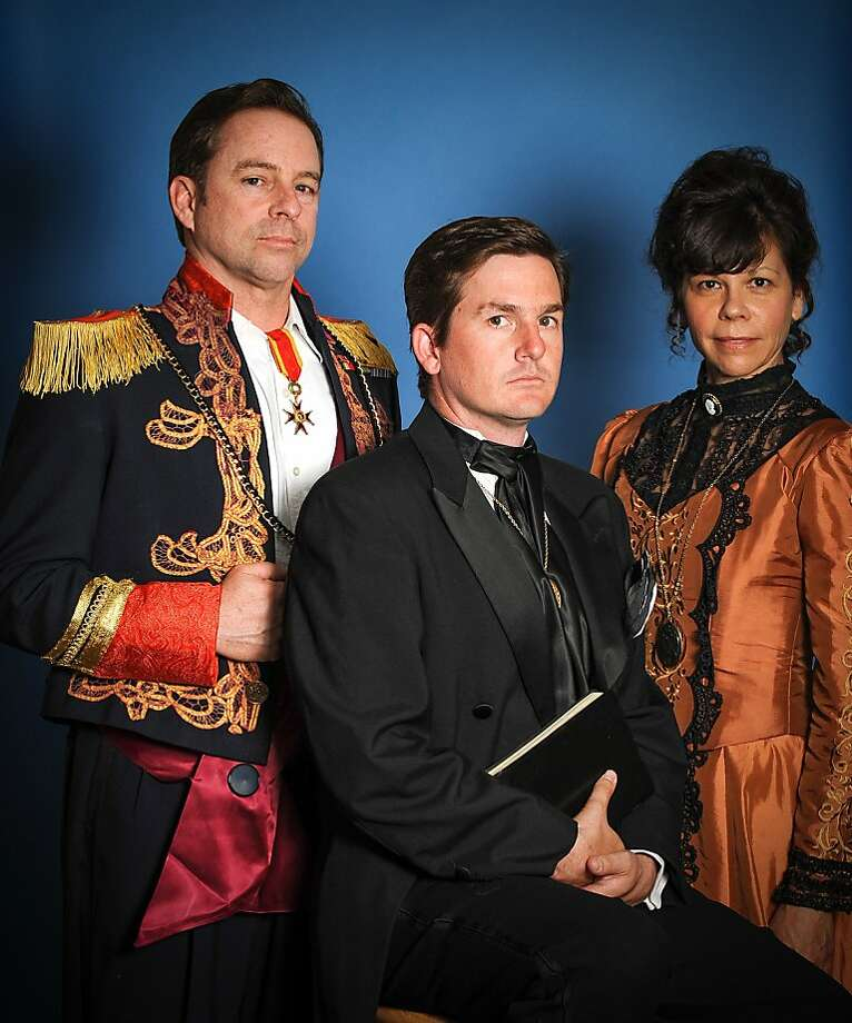 The royal family: Hamlet (Patrick Jones, center), flanked by his uncle-stepfather Claudius Michael Storm, left) and mother Gertrude (Nancy Sauder) Photo: Kenneth Alexander