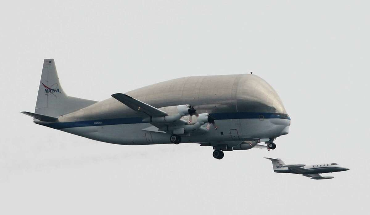 NASA's Super Guppy airplane flies over downtown Seattle.