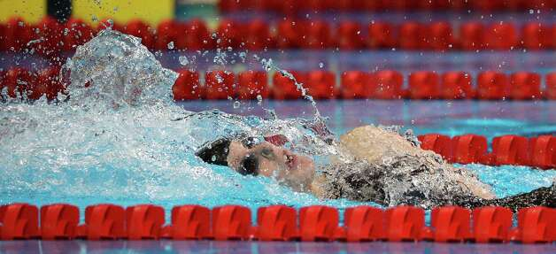 Missy Franklin swims in the women's 200-meter backstroke preliminaries at the U.S. Olympic swimming trials on Saturday, June 30, 2012, in Omaha, Neb. (AP Photo/Mark J. Terrill) Photo: Associated Press