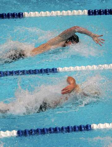Jimmy Feigen, top, and Josh Schneider swim in the men's 50-meter freestyle preliminaries the U.S. Olympic swimming trials, Saturday, June 30, 2012, in Omaha, Neb. (AP Photo/Nati Harnik) Photo: Associated Press