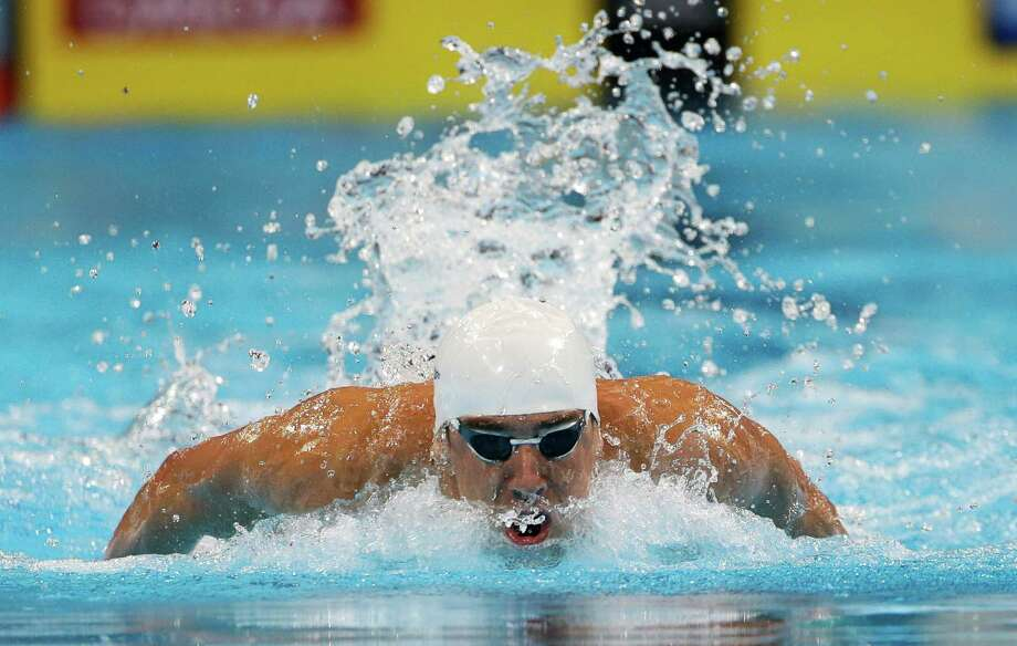 Michael Phelps swims in the men's 100-meter freestyle preliminaries at the U.S. Olympic swimming trials on Saturday, June 30, 2012, in Omaha, Neb. (AP Photo/Mark Humphrey) Photo: Associated Press