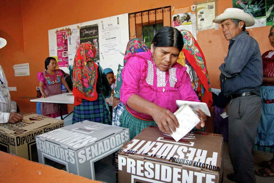 A woman casts her ballot at a polling station in Oaxaca, Mexico, Sunday, July 1, 2012. Mexico's more than 79 million voters head to the polls Sunday to elect a president, who serves one six-year term, as well as 500 congressional deputies and 128 senators. Photo:  Luis Alberto Cruz