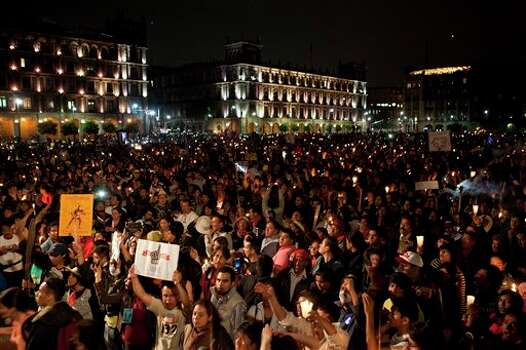 "Thousands of supporters of the ""I am 132"" movement stand in silence with torches and candles at the main Zocalo plaza in Mexico City, Saturday, June 30, 2012. The movement, which began in opposition of the alleged biased coverage by the media of  the 2012  elections and against the front running candidate Enrique Pena Nieto of the Revolutionary Institutional Party (PRI), are now demanding that the electoral institute does not rig the results in Sunday's July 1 elections. (AP Photo/Christian Palma) Photo: Associated Press"