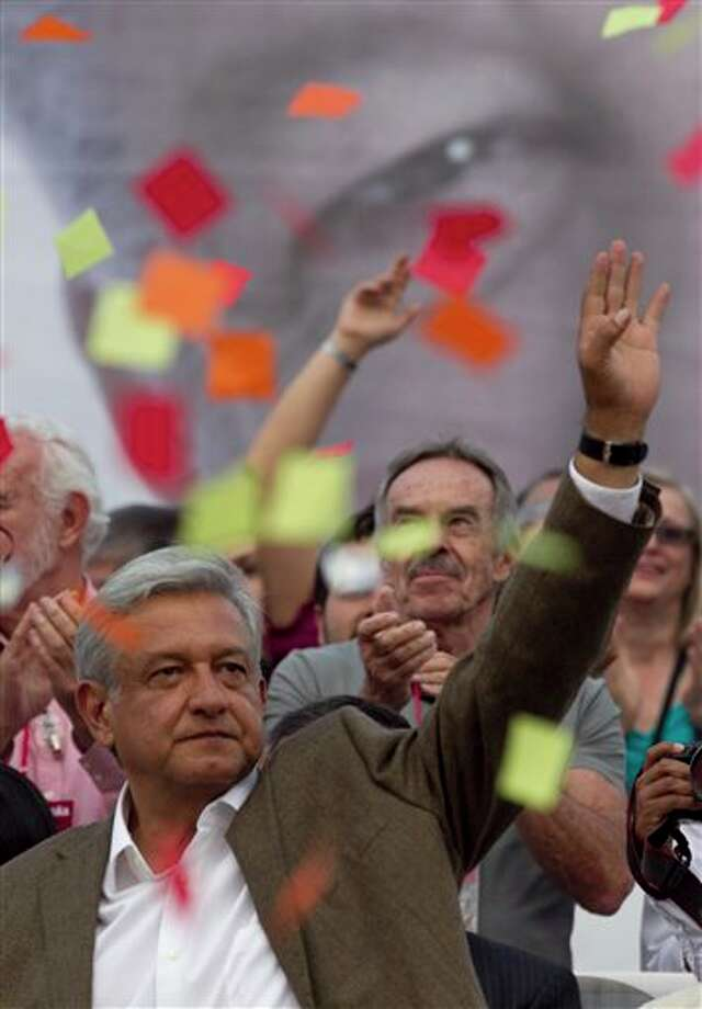 Andres Manuel Lopez Obrador, presidential candidate for the Democratic Revolution Party(PRD) waves at supporters during the closing rally of his campaign at the main Zocalo plaza in Mexico City, Wednesday, June 27, 2012. Next July 1, Mexico will hold presidential elections. (AP Photo/Esteban Felix) Photo: Associated Press