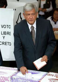 Mexican presidential candidate Andres Manuel Lopez Obrador of the Democratic Revolution Party (PRD)  casts his vote at a polling station in Mexico City, Sunday July 1, 2012.  Mexico's more than 79 million voters head to the polls Sunday to elect a president, who serves one six-year term, as well as 500 congressional deputies and 128 senators. (AP Photo/Eduardo Verdugo) Photo: Associated Press