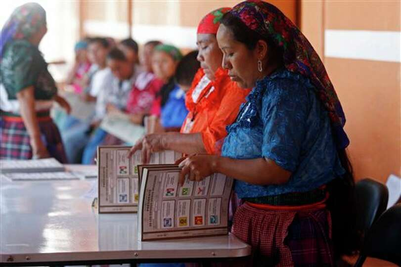 Electoral workers prepare ballots at a polling station in Oaxaca, Mexico, Sunday, July 1, 2012. Mexi