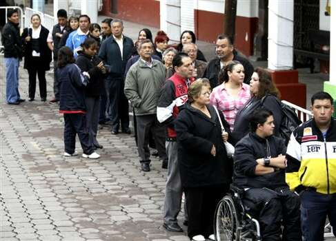 People wait in line to cast their vote in the city of Atlacomulco, Mexico, Sunday July 1, 2012. Mexico's more than 79 million voters head to the polls Sunday to elect a president, who serves one six-year term, as well as 500 congressional deputies and 128 senators. (AP Photo/Dario Lopez-Mills) Photo: Associated Press
