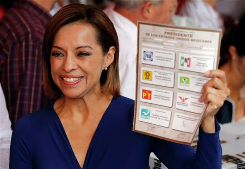 Josefina Vazquez Mota, presidential candidate of the ruling National Action Party (PAN), holds up an