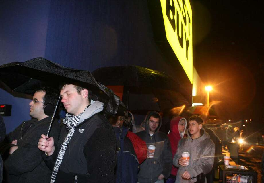 Black Friday shoppers, Jason Ferreira, left, and Stephen Mahon, both of Stratford,  wait in line at  Best Buy  in Trumbull on Friday, Nov.28, 2009. They joined the line at 3pm on Thursday looking for good deals on computers. Photo: B.K. Angeletti / Connecticut Post