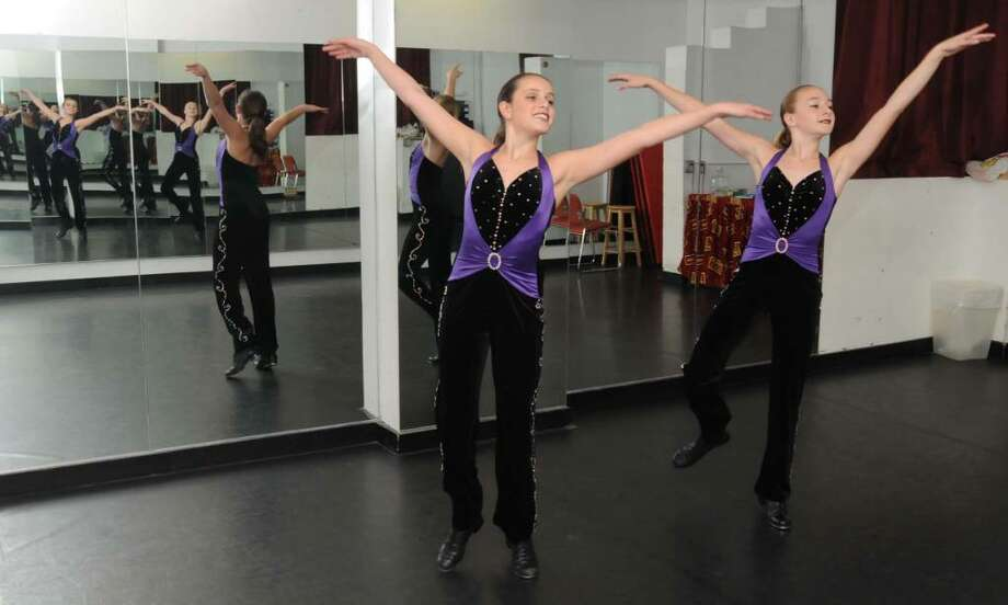 Isabella Vieira, 11,on the left, of Brewster, NY and Rachel Binney, 12, of Danbury, CT. practice the tap routine that they perform together at their dance school, Seven Star School of Performing Arts, in Brewster, N.Y. on Thursday Nov. 12, 2009. The two were selected to be on the U.S. Tap Team and will be traveling to Europe to compete in the World Tap Dance Championships. Photo: Lisa Weir / The News-Times
