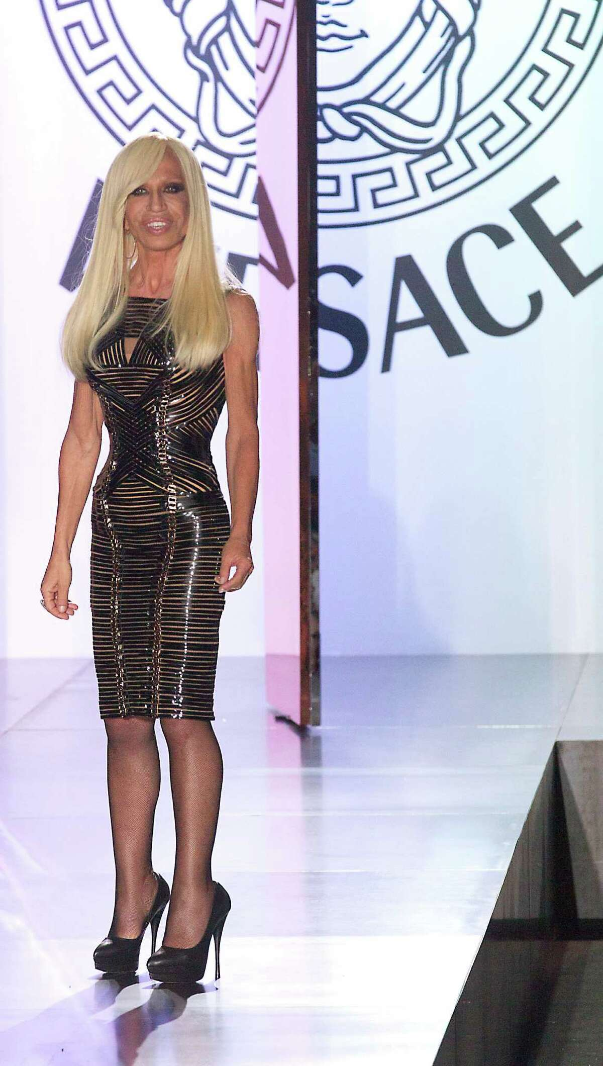 Fashion designer Donatella Versace appears at the end of her Women's Fall Winter 2013 haute couture fashion collection in Paris, France, Sunday, July 1, 2012.