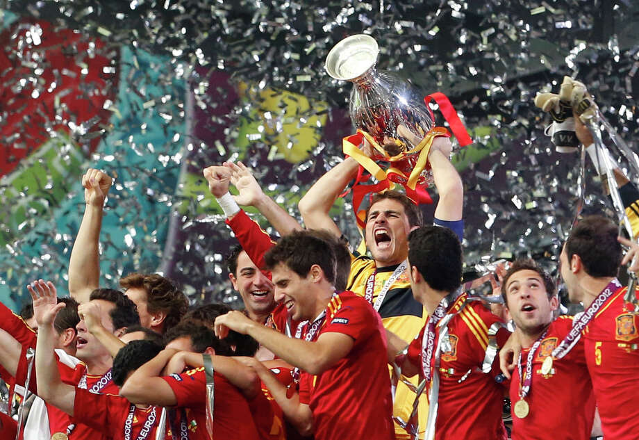 Spain goalkeeper Iker Casillas lifts the trophy after the Euro 2012 soccer championship final  between Spain and Italy in Kiev, Ukraine, Sunday, July 1, 2012. Spain won the match 4-0. Photo: AP