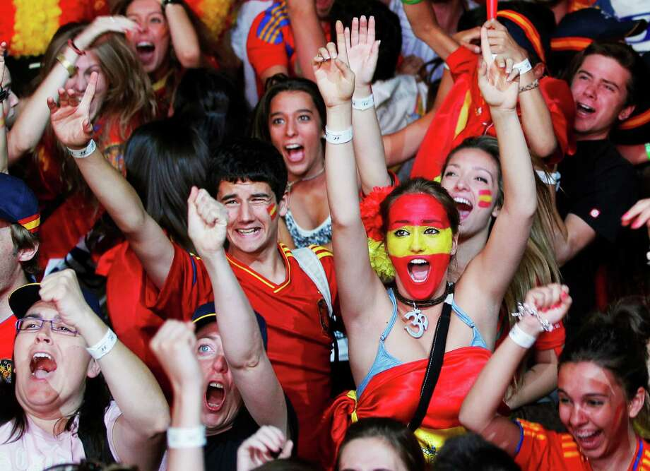 Spanish fans celebrate during the viewing of Euro 2012 soccer championship final match between Spain and Italy at the Fan Zone in Madrid, Spain, Sunday, July 1, 2012. Photo: Andres Kudacki