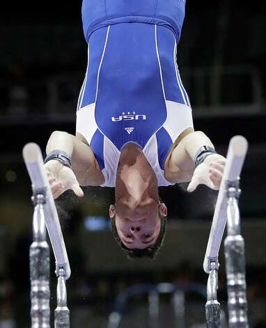 Alexander Naddour competes on the parallel bars during the preliminary round of the men's Olympic gymnastics trials Thursday, June 28, 2012, in San Jose, Calif.  (AP Photo/Gregory Bull) Photo: Associated Press