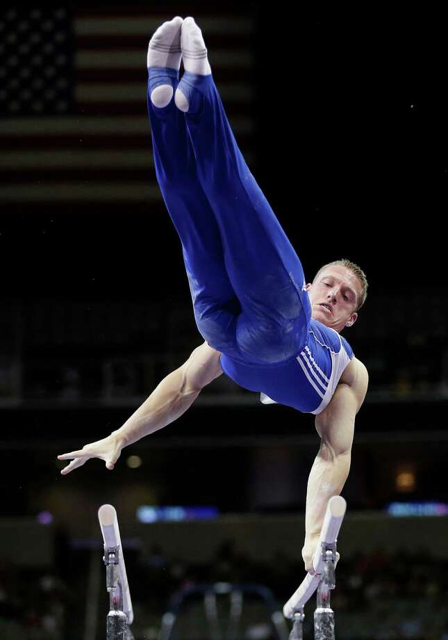 Steve Legendre competes on the parallel bars during the preliminary round of the men's Olympic gymnastics trials Thursday, June 28, 2012, in San Jose, Calif.  (AP Photo/Gregory Bull) Photo: Associated Press