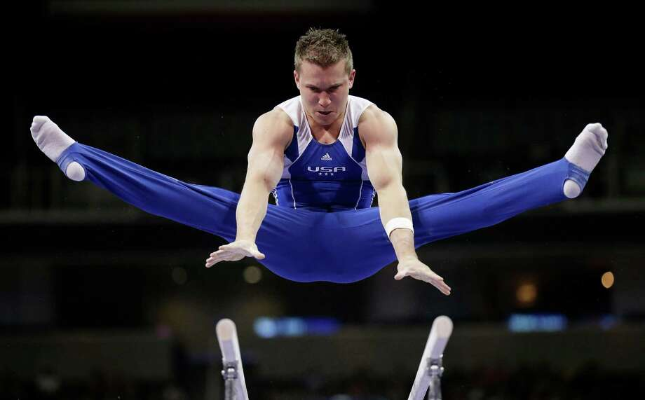 Jonathan Horton competes on the parallel bars during the preliminary round of the men's Olympic gymnastics trials Thursday, June 28, 2012, in San Jose, Calif.  (AP Photo/Gregory Bull) Photo: Associated Press