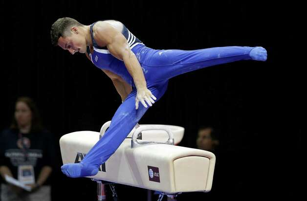 Brandon Wynn performs on the pommel horse during the preliminary round of the men's Olympic gymnastics trials Thursday, June 28, 2012, in San Jose, Calif.  (AP Photo/Gregory Bull) Photo: Associated Press
