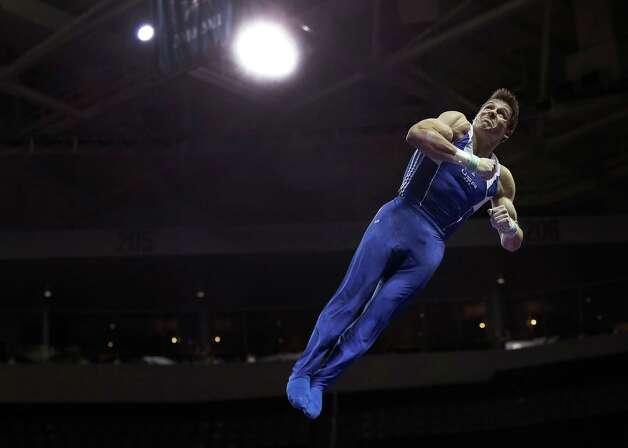 Chris Brooks competes on the horizontal bar during the preliminary round of the men's Olympic gymnastics trials Thursday, June 28, 2012, in San Jose, Calif.  (AP Photo/Gregory Bull) Photo: Associated Press