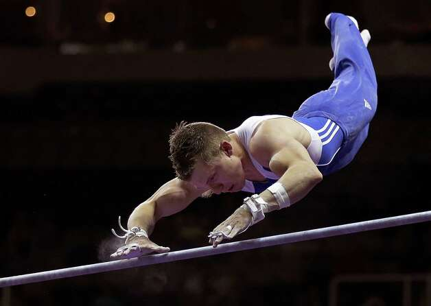 Jonathan Horton misses his grip on the horizontal bar during the preliminary round of the men's Olympic gymnastics trials Thursday, June 28, 2012, in San Jose, Calif.  (AP Photo/Gregory Bull) Photo: Associated Press