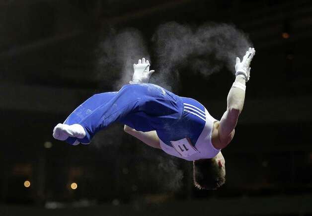 Jonathan Horton competes during the preliminary round of the men's Olympic gymnastics trials Thursday, June 28, 2012, in San Jose, Calif.  (AP Photo/Gregory Bull) Photo: Associated Press