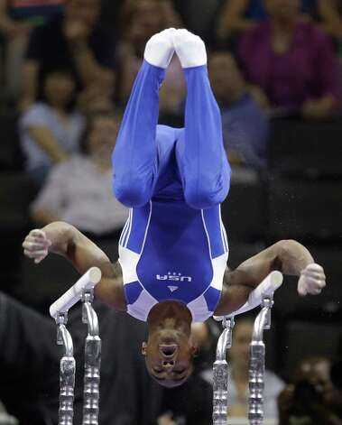John Orozco competes on the parallel bars during the preliminary round of the men's Olympic gymnastics trials Thursday, June 28, 2012, in San Jose, Calif. Orozco stands in second place overall after the preliminaries. (AP Photo/Jae C. Hong) Photo: Associated Press