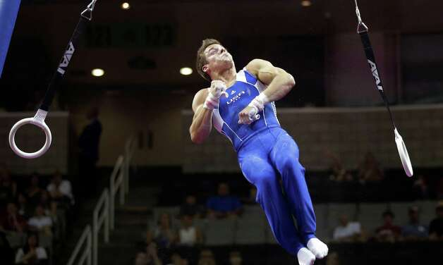 Sam Mikulak dismounts the rings during the preliminary round of the men's Olympic gymnastics trials Thursday, June 28, 2012, in San Jose, Calif.  Mikulak sits in third place after the preliminaries. (AP Photo/Jae C. Hong) Photo: Associated Press