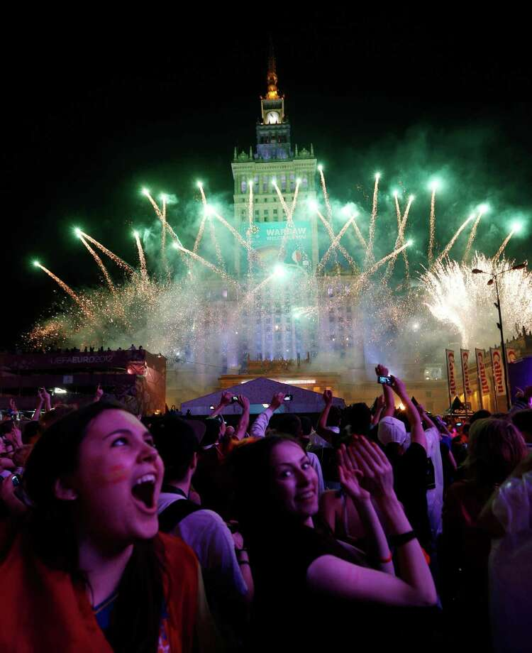 Soccer fans view fireworks in the Warsaw Fan Zone  after watching Sunday's Euro 2012 soccer championship final match between Spain and Italy in Warsaw, Poland , Sunday, July 1, 2012. Photo: AP