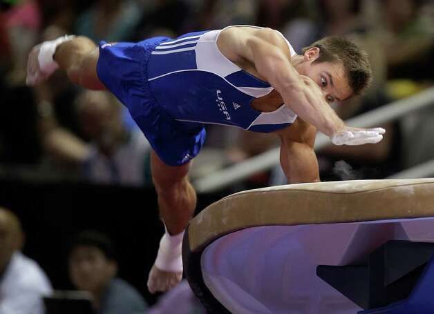 Sam Mikulak pushes off the vault during the preliminary round of the men's Olympic gymnastics trials Thursday, June 28, 2012, in San Jose, Calif.  (AP Photo/Jae C. Hong) Photo: Associated Press