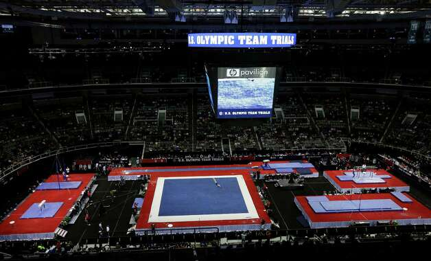Gymnasts compete during the preliminary round of the men's Olympic gymnastics trials Thursday, June 28, 2012, in San Jose, Calif.  (AP Photo/Gregory Bull) Photo: Associated Press