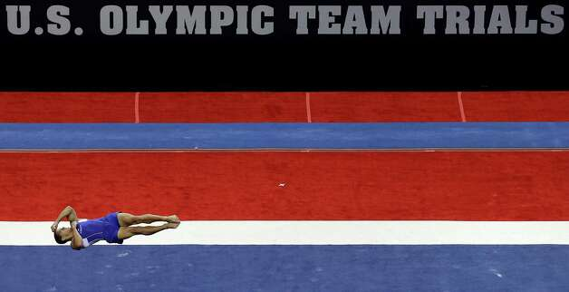 Jacob Dalton performs in the floor exercise event during the preliminary round of the men's Olympic gymnastics trials Thursday, June 28, 2012, in San Jose, Calif.  (AP Photo/Gregory Bull) Photo: Associated Press