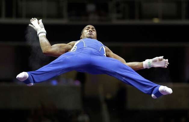Josh Dixon flies high above the horizontal bar during the preliminary round of the men's Olympic gymnastics trials Thursday, June 28, 2012, in San Jose, Calif.  (AP Photo/Jae C. Hong) Photo: Associated Press