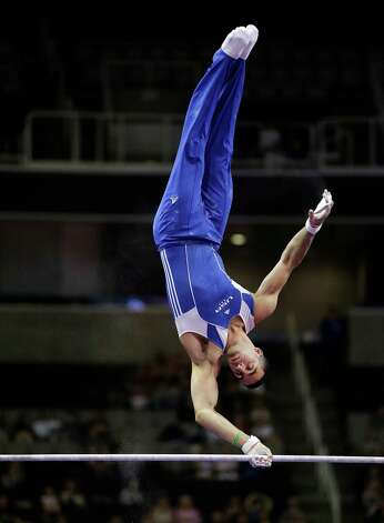 Danell Leyva competes on the horizontal bar during the preliminary round of the men's Olympic gymnastics trials Thursday, June 28, 2012, in San Jose, Calif.  (AP Photo/Jae C. Hong) Photo: Associated Press