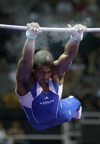 John Orozco finds his grip as he comes down on the horizontal bar during the preliminary round of the men's Olympic gymnastics trials Thursday, June 28, 2012, in San Jose, Calif.  (AP Photo/Jae C. Hong) Photo: Associated Press