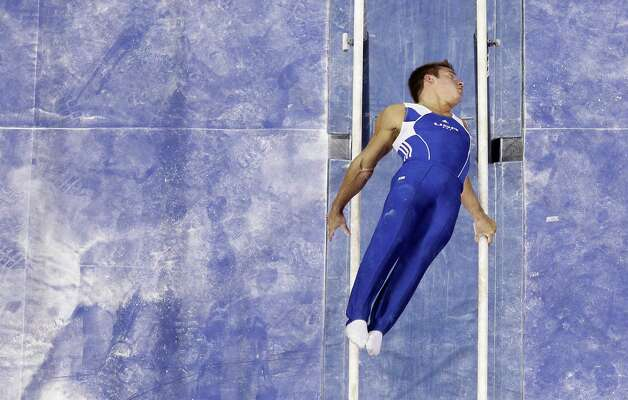 Sam Mikulak performs on the parallel bars during the preliminary round of the men's Olympic gymnastics trials Thursday, June 28, 2012, in San Jose, Calif.  (AP Photo/Julie Jacobson) Photo: Associated Press