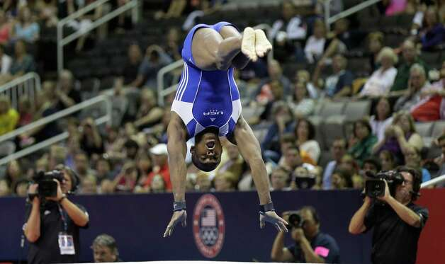 John Orozco competes in the floor exercise during the preliminary round of the men's Olympic gymnastics trials Thursday, June 28, 2012, in San Jose, Calif.  (AP Photo/Gregory Bull) Photo: Associated Press
